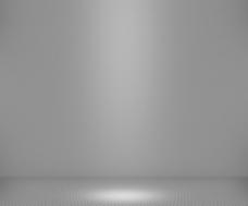 简单的聚光灯下的灰色背景