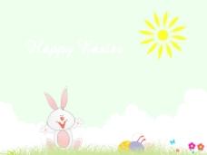 在地面上的绿色背景的兔子和蛋