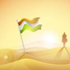 印度国旗在轮廓的士兵在晚上背景的沙漠